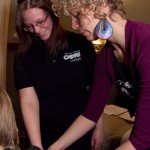 Instructor Demonstrating Arm Massage Techniques